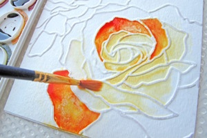 sketch your drawing,outline your sketch in Elmer's glue then paint it with water colors